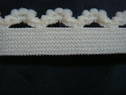 1 yard of creme color velvety elastic picot trim.1/2 w
