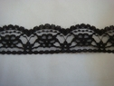 1 yard of double scalloped black floral lace trim. 1 1/4 W L6-3