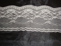 1 yard of double scalloped white lace trim. 3 5/8 W L6-1