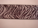 1 yard of Elastic Silver and metallic brown Zebra print trim. 2 1/2 w