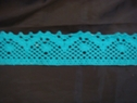 Turquoise scalloped crochet trim. 1 3/8 W 500u
