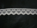 1 yard of white double scalloped lace trim. 1 w L1-1