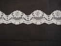 1 yard of white floral double scalloped lace trim. 1 7/8 W L6-3