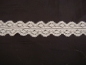 1 yard of white floral double scalloped lace trim. 1 W L6-4