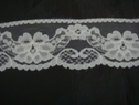 White scalloped floral lace trim. 1 3/4 W L6-2