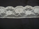 1 yard of white scalloped floral with silver beads lace trim. 2 1/2 W L6-2