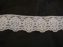 1 yard of white scalloped lace trim. 1 1/2 w L8-7