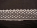 1 yard of white scalloped lace trim. 1 W L6-4