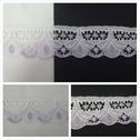 White with lilac scalloped lace trim 1 1/4 inches wide. L6-2