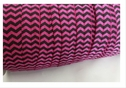 10 yards chevron azalea with black fold over elastic trim 5/8 inches wide.