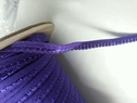 wholesale roll of 200 yards of shiny purple picot elastic trim 3/8 inch wide.