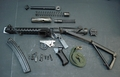 British Sterling Parts Set Demilled Barrel ..One Magazine Included....one available