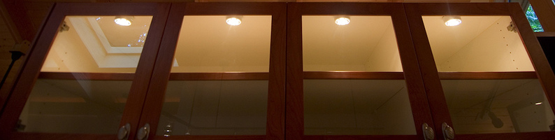 Puck lights installed inside a cabinet