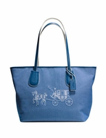 COACH Embossed Horse and Carriage Taxi Zip Shoulder Tote in Canvas