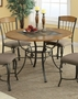 Coaster Round Dining Room Table in Medium Oak