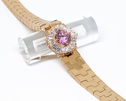 1-0663-f210 18kt Brazilian Gold Plated Fancy Pink CZ and White Baguette Accented Bracelet. 7.5 inches.