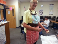 Kayla, high school science teacher extraordinaire, won this apron in our Mother's Day Contest!