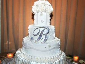 Chic Ivory 3 Tier Wedding Cake With Black Ribbon Detail And Crystal Monogram Topper