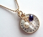 Gold Framed Sterling Silver Charm Necklace - click to Enlarge