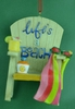 Item # 483773 - Life's A Beach Chair Christmas Ornament