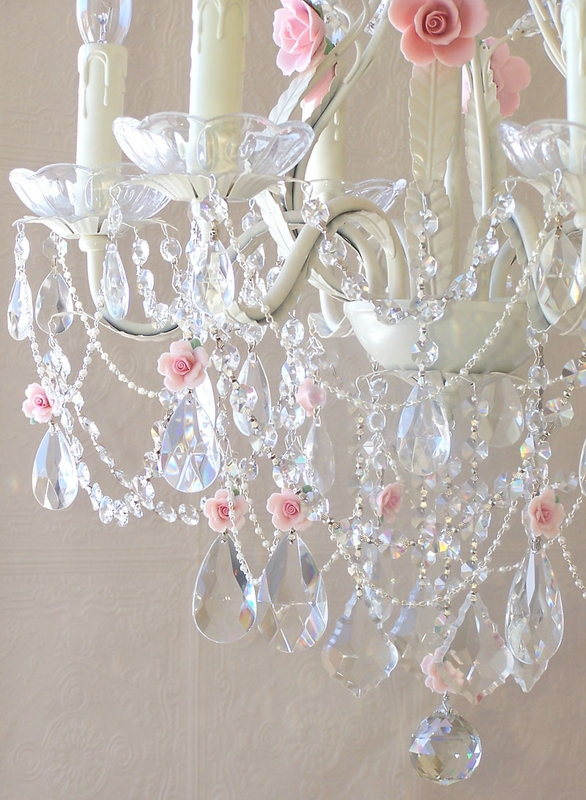 light crystal chandelier with pink porcelain roses