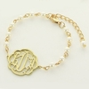 Goldtone Flourish Monogram Gold and Pearl Bracelet