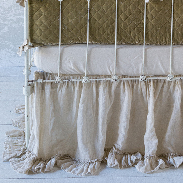 Crib bed skirts, also called crib dust ruffles, are one of the more decorative items you will buy for your baby's nursery. They primarily enhance the look of a nursery. That said crib skirts can also serve the purpose of hiding any items you might store under the crib.