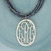 Sterling Silver Medium Oval Rimmed Cut Out Monogram Pendant