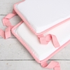 White Pique with Light Pink Piping Crib Bumper