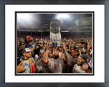 Mike Napoli holds the World Series Trophy Game 6 of the 2013 World Series Framed Picture