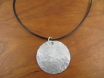 Hammered sterling disc pendant necklace on leather