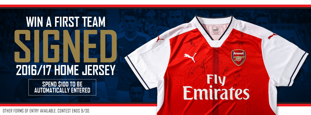 Win a team signed home kit!