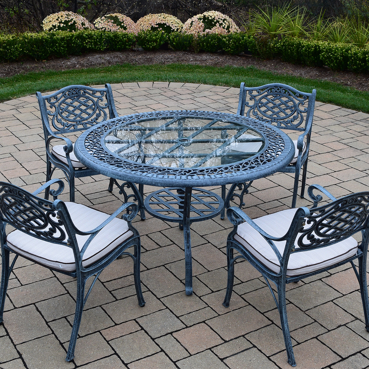 patio dining set with 48 inch round table and 4 cushioned arm chairs