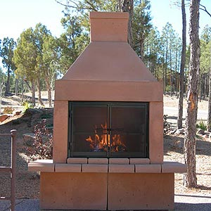mirage open outdoor gas fireplace with gas logs