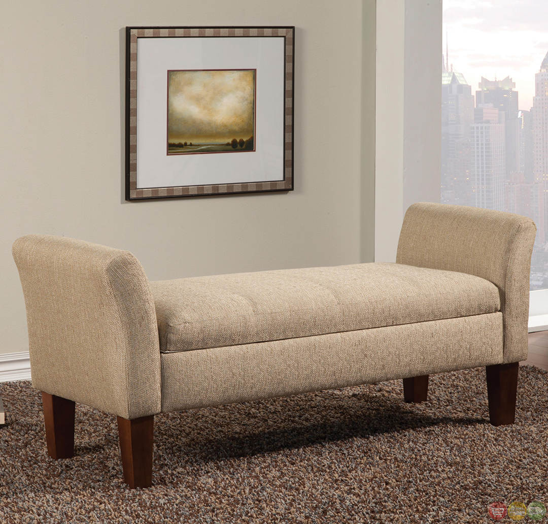 light tan fabric upholstered storage bench with flared arms