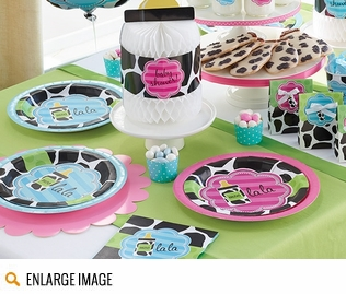 The Baby Cow Print Boy Shower theme includes adorable decorations in lime green polka dots and bright blue stripes with cow print baby bottles.
