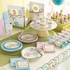 Baby Shower Favors and decorations shown on beautifully decorated tables.