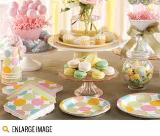 Aqua Dots party supplies featuring pastel blue and classic white polka dots placed upon a rich chocolately brown background.