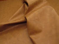 4 3/8 yards of tan, beige heavy vinyl upholstery fabric