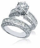 Trevino 1.5 Carat Round Prong Set Cubic Zirconia Channel Set Princess Cut Wedding Set