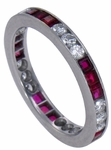 Triple Cubic Zirconia Round and Simulated Ruby Princess Cut Eternity Band