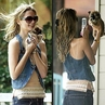Mischa Barton snaps a pic of a puppy at a pet store.