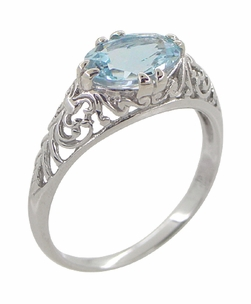 Edwardian Oval Sky Blue Topaz Filigree Engagement Ring in 14 Karat White Gold - Item R799WBT - Image 1