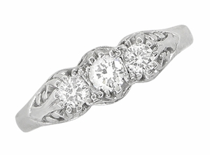 Art Deco Filigree 3 Stone Diamond Ring in Platinum - Click to enlarge