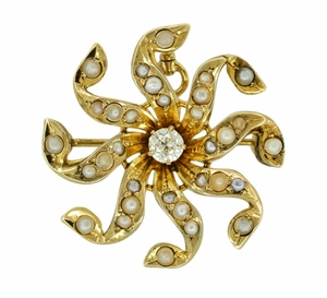 Antique Victorian Diamond and Seed Pearl Scroll Sunburst Pendant Brooch in 10 Karat Gold - Click to enlarge