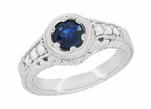 Art Deco Filigree Flowers and Scrolls Engraved Blue Sapphire and Diamond Engagement Ring in 18 Karat White Gold - Click to enlarge