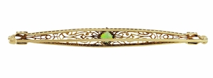 Art Deco Filigree Peridot Bar Brooch in 14 Karat White and Yellow Gold - Click to enlarge