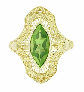 Art Deco Peridot Filigree Cocktail Ring in 14 Karat Yellow Gold - Click to enlarge