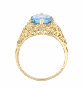 Art Deco Flowers and Leaves Swiss Blue Topaz Filigree Ring in 14 Karat Yellow Gold - December Birthstone - Click to enlarge