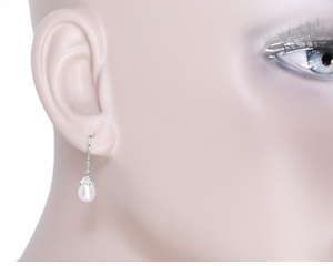 Art Deco Pearl Drop Earrings in 14 Karat White Gold - Click to enlarge
